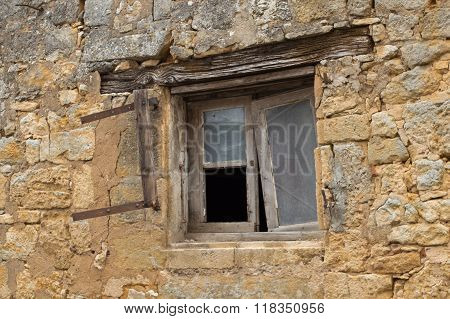Dilapidated Window In Stone House