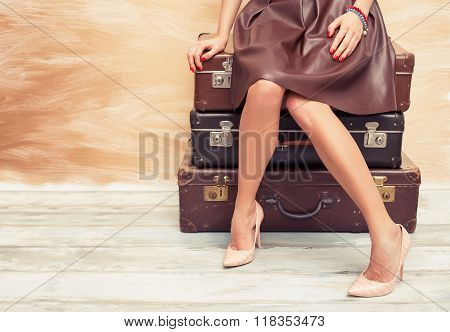 Woman sitting on suitcases
