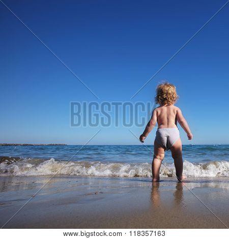 Baby Boy Walking On Sea
