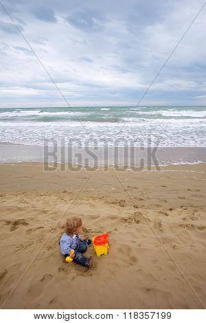 Boy With Toy Trowel Bucket