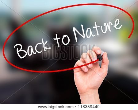 Man Hand Writing Back To Nature With Black Marker On Visual Screen