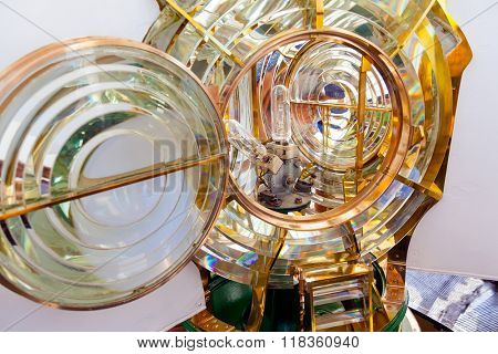 Close-up on a Fresnel optic system and light bulbs of a lighthouse. Espichel Cape Lighthouse in Sesimbra, Portugal.