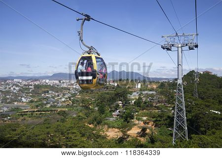 Cabin cable car with tourists rides by cable car in the city of Dalat. Vietnam