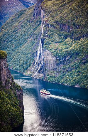 Geiranger fjord, waterfall Seven Sisters. It is a 15-kilometre (9.3 mi) long branch off of the Sunnylvsfjorden, which is a branch off of the Storfjorden (Great Fjord). poster