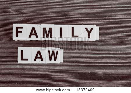 Blocks with letters regarding child-custody and family-law concept. Retro stylization