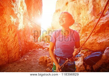 female belayer with the rope