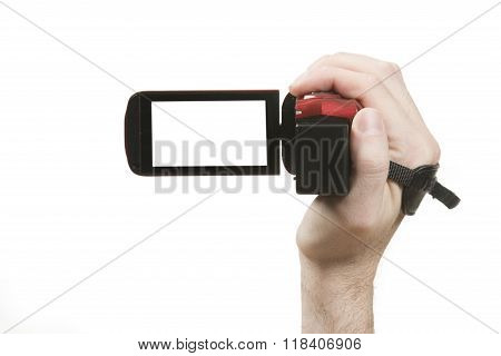 Hand holding a home video camcorder ready to record