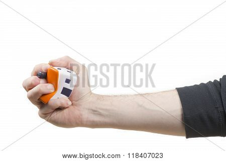 Streesball house being squashed by a male hand