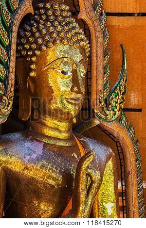 Golden buddha statue with mountain Wat Tham Sua(Tiger Cave Temple) Tha Moung Kanchanburi Thailand