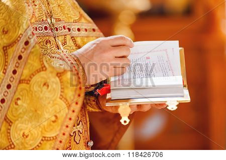 Prayer Book In The Hands Of The Priest. Ceremony In The Orthodox Christian Church. Russia.