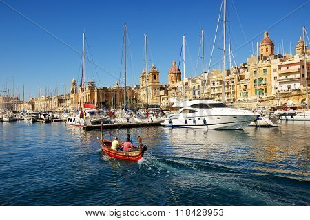 Birgu, Malta - April 22: The Traditional Maltese Boat For Tourists Cruises On April 22, 2015 In Birg