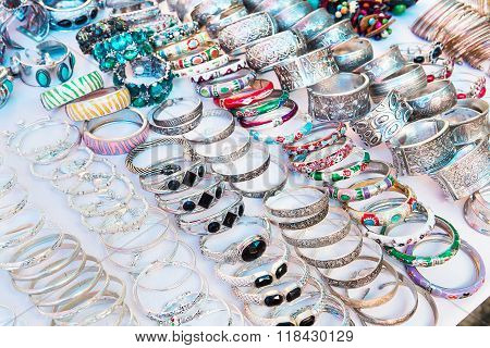 Beautiful expensive gold bracelets Bracelets on white cloth background