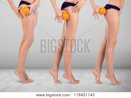 Woman with orange showing cellulite