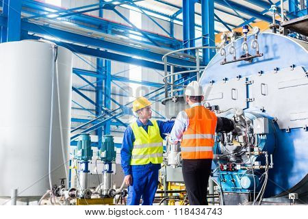 Worker and manager in industrial factory discussing acceptance of machine poster