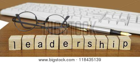 The Word Leadership On Wood Stamp