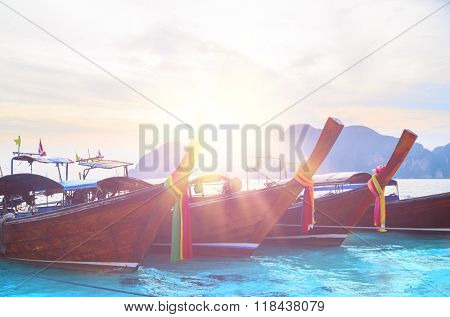 Long boats at tropical beach, closeup view during sunrise, Andaman Sea,Phi Phi Islands,Thailand