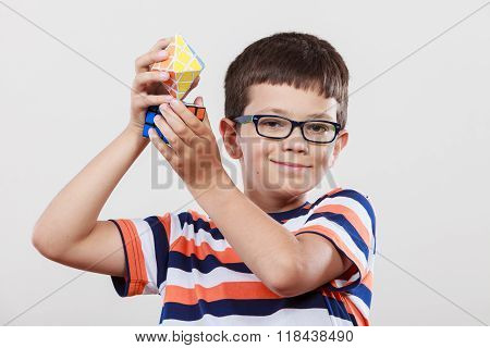 Smart Kid Little Boy With Magic Rubik Cube.