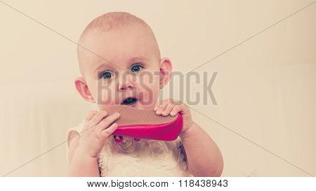 Baby Girl Biting Shoe