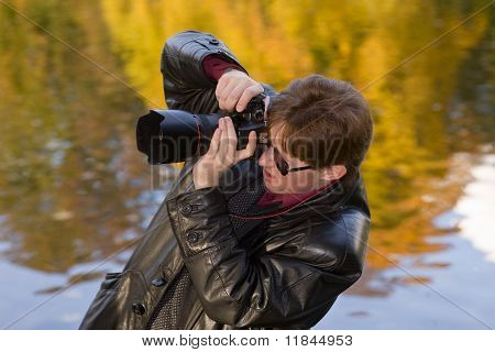 Photographer In The Autumn