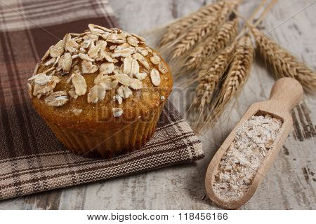 Fresh Muffin With Oatmeal, Rye Flour And Ears Of Rye Grain, Delicious Healthy Dessert