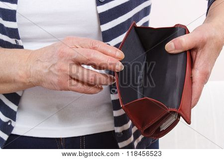 Hands Of Senior Woman Showing Empty Wallet, Concept Of Financial Security In Old Age