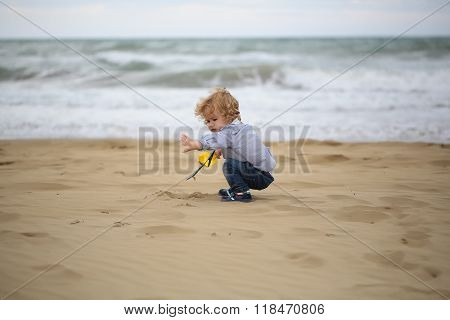 Boy Playing With Sand