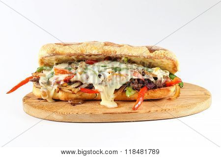 Tasty beef steak sandwich with onions, mushroom and melted provolone cheese