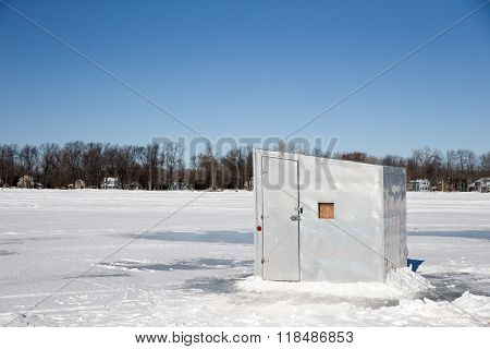 Ice Shanty On A Frozen Lake