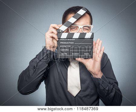 Film Director With Movir Clapper Board