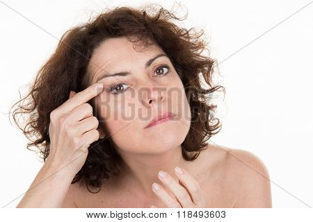 Woman Showing By Index Finger The Wrinkles On Her  Forehead
