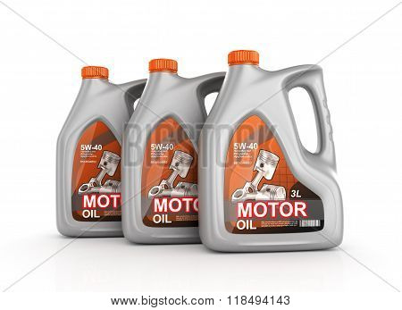 Three Cans Of Motor Oil Isolated On White Background.