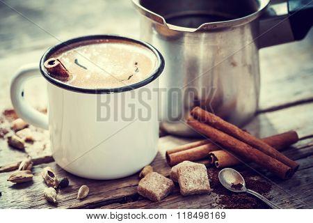 Coffee Mug With Cinnamon And Turkish Pot On Table. Retro Styled.