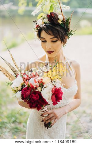 girl with a wedding bouquet boho style and a wreath on his head poster