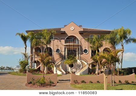 Mediterranean style three story waterfront home