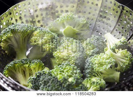 Freshly Steamed Green Broccoli In Skimmer Pot