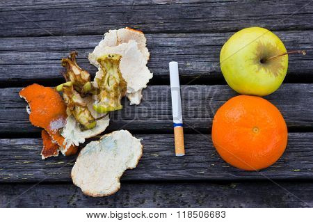 Fresh fruits near rotten
