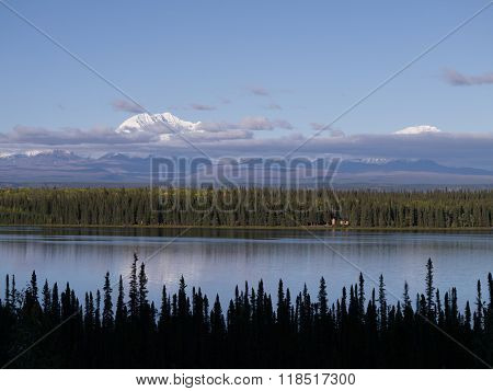 Solitary Lake Cabin On Large Mountain Lake