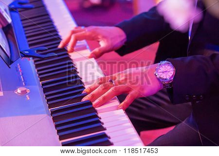 A Close-up Of Playing pianist