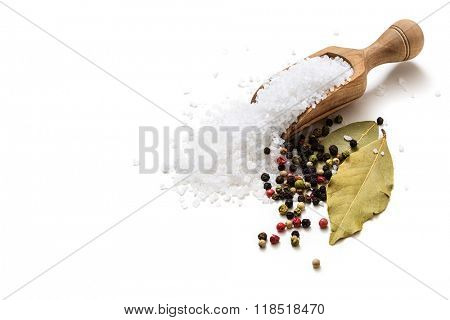 Sea salt, pepper and bay leaf on white background