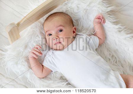 Cute Newborn Girl Lying In Bed