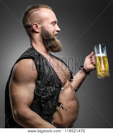 Smiling Biker With Beer Belly. Man Drinks Beer From A Mug