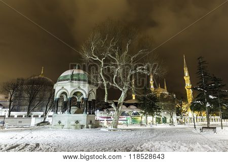 Snowy Winter Night View Of Sultanahmet Mosque And The German Fountain