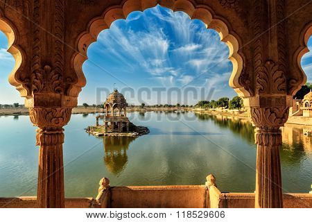 Indian landmark Gadi Sagar - artificial lake view through arch. Jaisalmer, Rajasthan, India