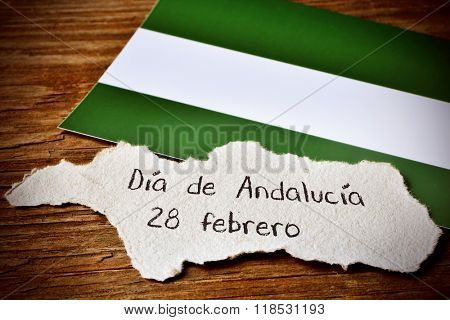 a piece of paper in the shape of Andalusia, in Spain, with the text Dia de Andalucia 28 de febrero, Day of Andalusia February 28, written in Spanish, and its regional flag poster