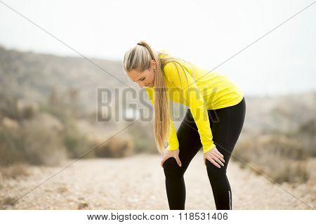 Young Exhausted Sport Woman Running Outdoors On Dirty Road Breathing