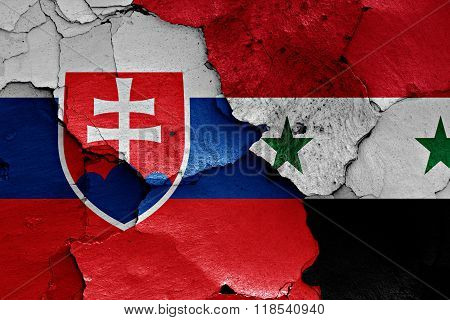 flags of Slovakia and Syria painted on cracked wall
