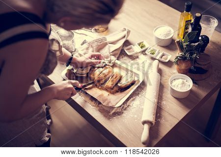 Preparing dough for homemade bread on wooden table in the kitchen.Cutting dough.Portions