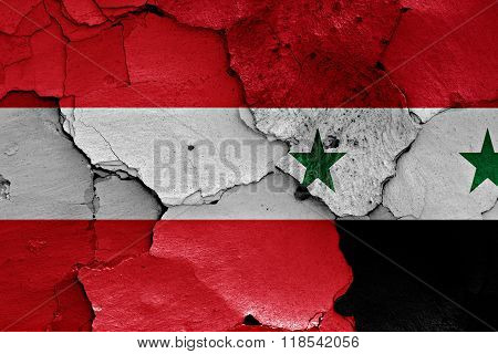 flags of Austria and Syria painted on cracked wall