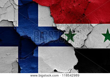 Flags Of Finland And Syria Painted On Cracked Wall