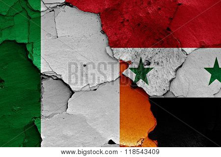 Flags Of Ireland And Syria Painted On Cracked Wall